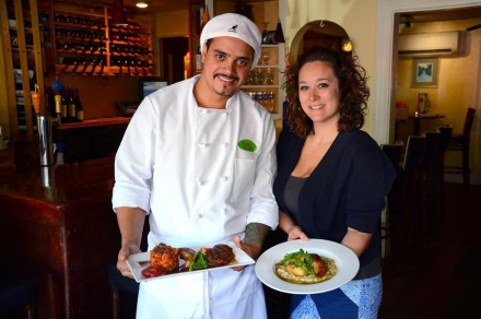 Chef Marcos DeSouza and manager Erica White with citrus glazed Long Island Duck Photo by Debee Tlumacki for The Boston Globe
